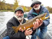 Guide Michael flippin and guest with brown trout.