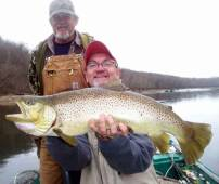 Guide Bob Flippin and his guest with beautiful brown trout.